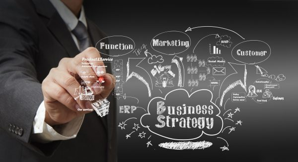business man writing business strategy G1sTm9rO 600x327 - business man writing business strategy